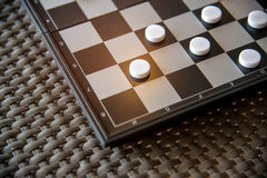 Checker board with checkers game.  royalty free stock photography