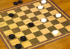 Checker board with checkers Royalty Free Stock Photo