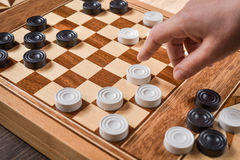 Checker board with checkers on wooden background . Nsport stock photo