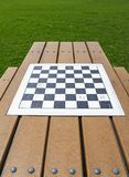 Checker board in a parc. Checker board on a picnic table in a parc stock photo