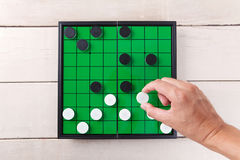 Checker game on green board view from above on table. Checker game on green board view from above on wood table stock photos