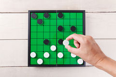 Checker game on green board view from above on table. Checker game on green board view from above on wood table royalty free stock images