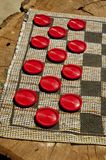 Checker game spread on an old log. Royalty Free Stock Photo