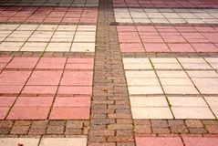 Checker pavement perspective. Converging lines on concrete and brick paving in bingham nottinghamshire Royalty Free Stock Photos