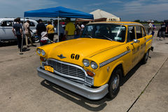 Checker Yellow Taxicab Royalty Free Stock Images