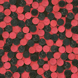 Red and Black Checkers on Checkerboard Stock Photo