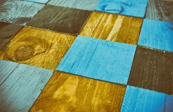Checkerboard blue, oak and black wood stock images