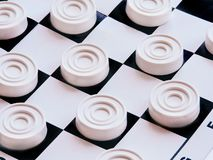Checkerboard with checkers. Business strategy competition, strategic planning for winning success. Hobby. Checkers on the playing field for a game. Black and stock photo