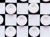 Checkerboard with checkers. Business strategy competition, strategic planning for winning success. Hobby. Checkers on the playing field for a game. Black and stock photography