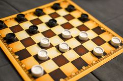 Checkerboard with checkers. Business strategy competition, strategic planning for winning success. Hobby. checkers on royalty free stock photo