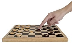 Chess board with chess pieces and a woman hand. White background royalty free stock photos