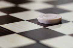 Checkerboard with checkers. Game concept. Board game. Hobby stock image