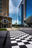 Checkerboard crosswalk and buildings in Charlotte, North Carolin Royalty Free Stock Photo