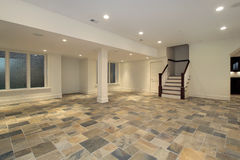 Checkerboard floor in lower level. Lower level with kitchen and checkboard slate floor royalty free stock images