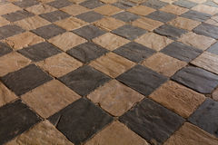 Checkerboard floor texture. Draughtboarded floor built in slate and limestone rocks in Spain Stock Image