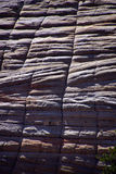 Checkerboard pattern of cross current sandstone layers. Created from fossilized dunes and shifting winds over millions of years, Zion National Park, Utah Royalty Free Stock Photo