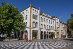 Checkerboard pattern in front of an old building in Osnabruck. Germany Stock Image