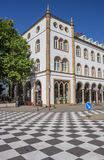Checkerboard pattern in front of an old building in Osnabruck. Germany Stock Photography