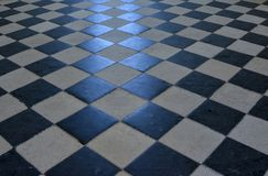 Checkerboard pattern on a stone floor. stock photography