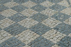 Checkerboard pavement. Cobblestones laid in checkerboard pattern Royalty Free Stock Photos