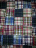 Checkerboard quilt in plaid. Hand-stitched cotton quilt pieced with various plaid fabrics Stock Photo
