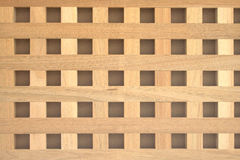 Checkerboard square-holed wood panel Royalty Free Stock Photo