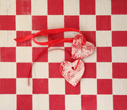 Checkerboard with two hearts Stock Photos