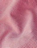 checkered близкий красный цвет пинка ткани вверх Стоковое Изображение RF