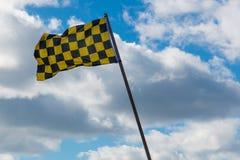 Checkered флаг с бурным небом Стоковые Изображения