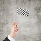 Checkered флаг в руке Стоковые Фото