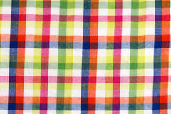 Checkered background. Of colored cotton fabric Stock Photography