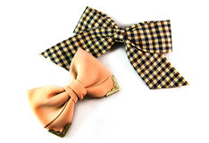 Checkered and beige bows for hair on a white background. Decorations for the head stock photos