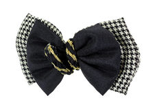 Checkered Black Bows Gold Braid Center. An attractive layered checkered design and black bow secured gold braid in center hair clip on a white background royalty free stock photography