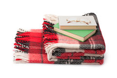 Checkered blanket books and glasses Royalty Free Stock Images