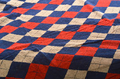 Checkered blue and red fragment of wrinkled cloth as a backgroun. Wrinkled towel dusty cell close up Royalty Free Stock Images