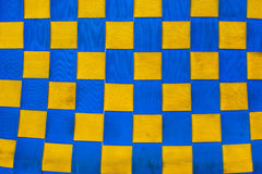 Checkered blue and yellow fabric texture Stock Images