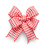 Checkered Bow. Red and white checkered ribbon bow isolated on white background clipping path included Royalty Free Stock Images