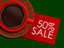 Checkered christmas coffee with discount card lying on tableclot Royalty Free Stock Images