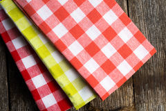 Checkered cloth napkins. On a rustic wood surface Stock Photography