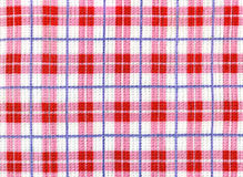 Checkered dishcloth background. With red cells stock images