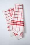 Checkered dishtowel. White and red checkered dishtowel on white background Royalty Free Stock Photography