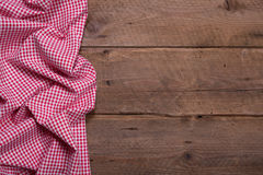 Checkered fabric as border on wooden background for christmas. Or for a menue card in a restaurant or for advertising or publicity - bavarian country style Stock Photo