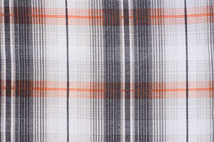 Checkered fabric background texture. White, black and orange color Royalty Free Stock Photo