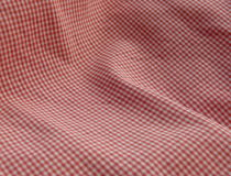 Checkered fabric close up. Red. Close up of pleated checkered cotton or linen fabric cloth Stock Photography