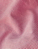 Checkered fabric close up. Red. Pink. Close up of pleated checkered fabric cloth Royalty Free Stock Image