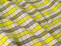 Checkered fabric close up. Yellow. Close up of pleated checkered fabric cloth Royalty Free Stock Photos