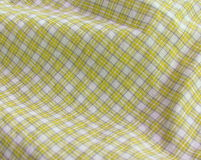 Checkered fabric close up. Yellow. Close up of pleated checkered fabric cloth Stock Photos