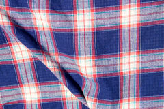 Checkered fabric plaid  texture. Traditional Scottish pattern. Cloth background Royalty Free Stock Photography