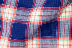 Checkered fabric plaid  texture. Traditional Scottish pattern Royalty Free Stock Photos