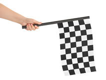 Checkered final flag. Checkered flag in hand isolated on white background royalty free stock photos